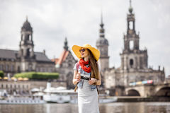 Woman traveling in Dresden city, Germany. Young woman tourist walking with photocamera near the river in the old town of Dresden, Germany stock photography