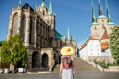 Woman traveling in Erfurt city, Germany. Morning view on the Mary Domberg cathedral with woman tourist in Erfurt city, Germany stock photos