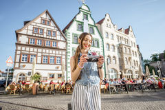 Woman traveling in Erfurt city, Germany. Portrait of a young woman tourist traveling with photo camera in the old town of Erfurt city, Germany royalty free stock photo