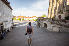 Woman traveling in Erfurt city, Germany. Young woman tourist standing back on the stairs of Mary Domberg cathedral in Erfurt city, Germany Royalty Free Stock Photo