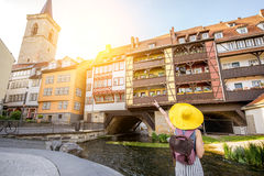 Woman traveling in Erfurt city, Germany. Young woman tourist in yellow hat standing back on the famous Merchants bridge background in Erfurt city, Germany stock photos