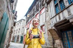 Woman traveling in french town Dinan Stock Photos