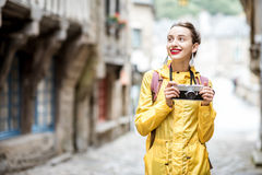 Woman traveling in french town Dinan Stock Photography