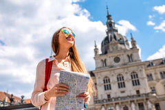 Woman traveling in Graz, Austria. Young woman traveling with map in the central square in Graz old town. Traveling in Austria Royalty Free Stock Image