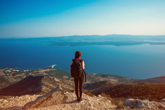 Woman traveling on the island top Stock Photo