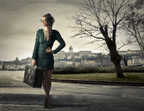 Woman traveling with luggage Royalty Free Stock Photo