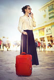 Woman traveling with luggage Stock Photos
