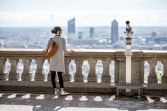 Woman traveling in Lyon. Woman enjoying great view on Lyon city with skyscrapers during the morning in France Royalty Free Stock Photography