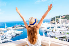Woman traveling in Monaco. Young female traveler enjoying great view on the harbor with yachts in Monte Carlo in Monaco stock images