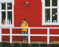 Woman traveling in Norway red house wall on background Travel Lifestyle Royalty Free Stock Photos