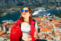 Woman traveling in old city Kotor, Montenegro Stock Image