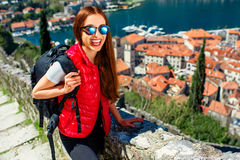 Woman traveling in old city Kotor, Montenegro Royalty Free Stock Image