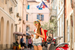 Woman traveling in the old town Stock Images