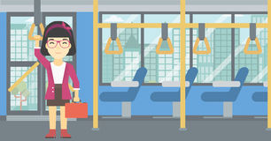Woman traveling by public transport. Stock Photo
