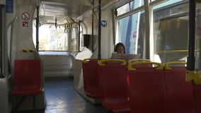Woman traveling in public transport stock video