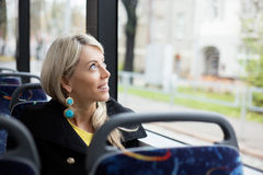 Woman traveling in public transport Stock Image