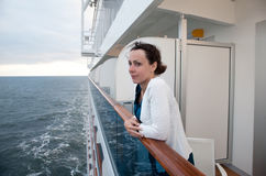 Woman traveling on ship and hold on handrails Stock Photography