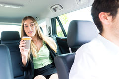 Woman traveling in taxi, she has an appointment Royalty Free Stock Images