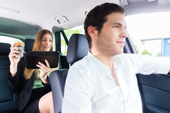 Woman traveling in taxi, she has an appointment Royalty Free Stock Photography