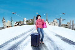 Woman Traveling to The World Monument Stock Photo