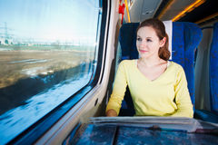 Woman traveling by train Stock Photo