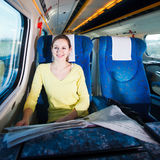 Woman traveling by train Royalty Free Stock Photo