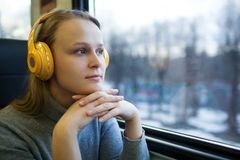 Woman traveling by train with favorite music Royalty Free Stock Photos