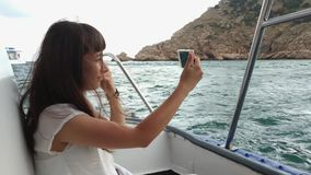 Woman traveling by yacht stock video footage