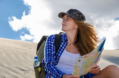 Woman traveller in the desert Stock Images