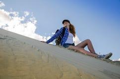 Woman traveller in the desert Stock Photo