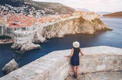 Woman traveller at Dubrovnik Old Town, Croatia. Woman traveller at Dubrovnik Old Town, in Dalmatia, Croatia - The prominent travel destination of Croatia stock images