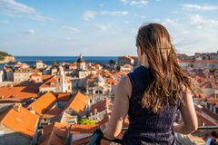 Woman traveller at Dubrovnik Old Town, Croatia. Woman traveller at Dubrovnik Old Town, in Dalmatia, Croatia - The prominent travel destination of Croatia royalty free stock photography