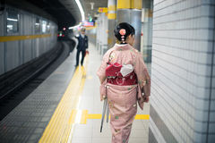 Woman traveller in Kimono dress at subway station Royalty Free Stock Photography