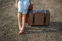 Woman traveller with vintage luggage Stock Photos