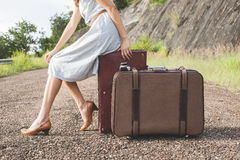 Woman traveller with vintage lugguage in retro color royalty free stock photography