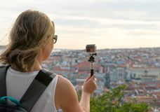 Woman traveller. Woman traveller with camera shooting video Stock Photography