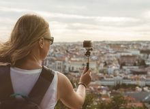 Woman traveller. Woman traveller with camera shooting video Royalty Free Stock Photos