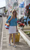 Woman travelling alone in seaside town Royalty Free Stock Photography