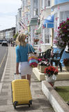 Woman travelling alone in seaside town Stock Image