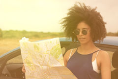 Woman travelling alone using map Stock Images