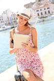 Woman travelling looking at map on tablet Stock Photography