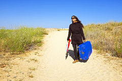 Woman travelling to her destinatination Royalty Free Stock Photos