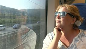 A woman travelling by train . The journey by train Stock Images