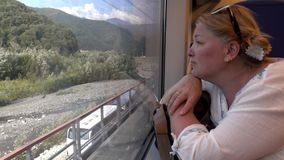 A woman travelling by train . Transport stock footage