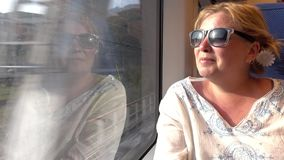 A woman travelling by train . Transport stock video