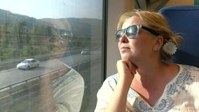 A woman travelling by train . Transport stock video footage