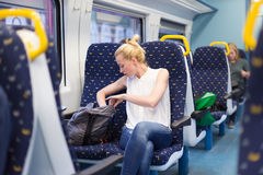 Woman travelling by train. Stock Photos