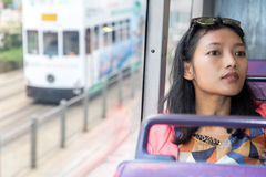 Woman travels with a double-decker bus Royalty Free Stock Photos