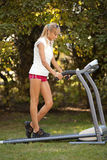 Woman on the treadmill Royalty Free Stock Image