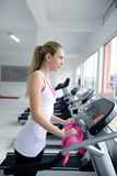 Woman on treadmill at the gym Royalty Free Stock Photography